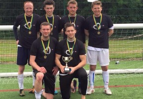 The winning team from the 2015 Football Tournament raising £3,000
