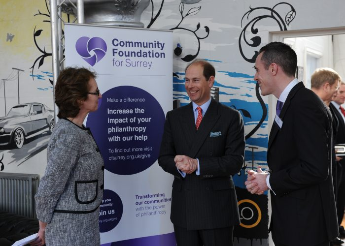 Executive Director Wendy Varcoe talks with HRH The Earl of Wessex and Joe Crome of Leatherhead Youth Project